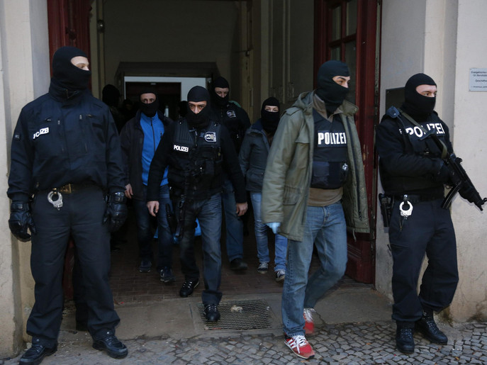 German special police units leave an apartment building in the Wedding district in Berlin